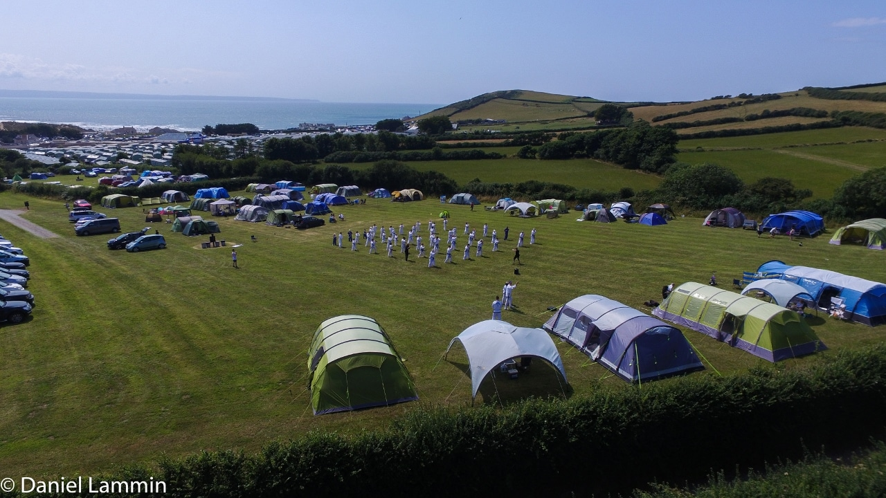 Summer camp: tents and taekwondo students in field